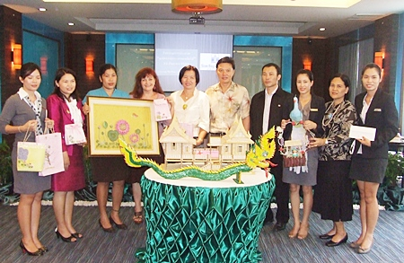 Siam Bayview's technical department won first prize with their Traditional Thai house (center).  Housekeeping took second place with a framed artwork of a bed of flowers (left), and the Accounting Department's figure of a mythical phoenix (right) won third place.