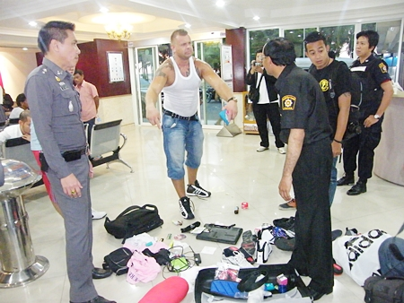 The agitated man dumped his belongings on the police station floor and walked away.