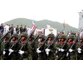 Troops march past the soon to be retired Chief of Defense Forces Gen. Songkitti Jaggabatara.