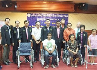 Mayor Itthiphol Kunplome presides over the distribution of 263 pairs of glasses, four wheelchairs and five walkers to elderly, disabled and visually impaired residents.