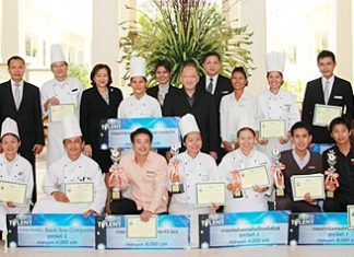The winners in various categories from the 2011 Pattaya's Bartender Got Talent Competition show their plaques and trophies as the management of Dusit Thani Pattaya, led by General Manager Chatchawal Supachayanont (centre), proudly pose with them after a small congratulatory ceremony held at the resort.
