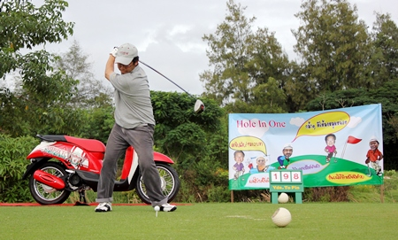 A player tees off hoping to win the Honda Scoopy hole in one prize.