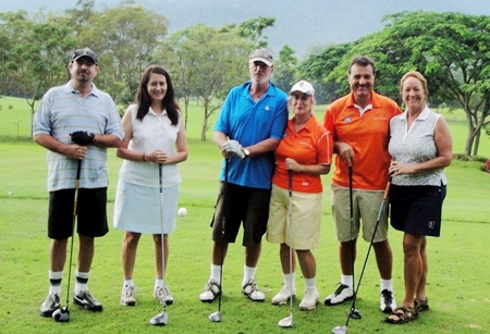 The girls and their partners get some early practice in at Soi Dao Highlands Golf Resort.