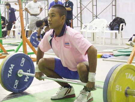 Thailand's Sinphet Kruaithong warms up back stage before successfully competing in the 50kg Boys division.