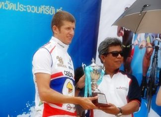 Stephane Bringer (left) receives his trophy after finishing first in his age group and third overall at the Queen's Cup Hua Hin International Triathlon 2011.