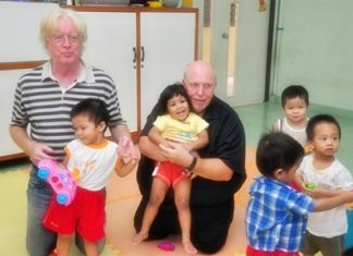 Calli and Thai national football coach Winfried Schäfer meet the orphanage kids prior to the tournament.