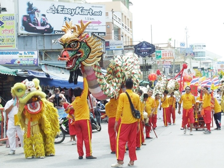 Lions and dragons make their way up Walking Street. (Photo by Phasakorn Channgam)