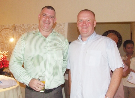 The ever familiar face of Joe Cox from Defense International Security Services with Earl Brown from the Sutlet Group.