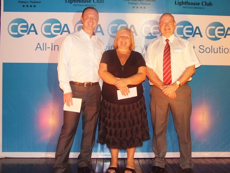 Tracy Cosgrove receives 20,000 baht from Scott Tierney and Graham Macdonald of MBMG.