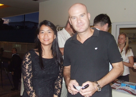 Chanita Thannikornget gets Stuart Daly to refrain from singing for a quick photo opportunity.