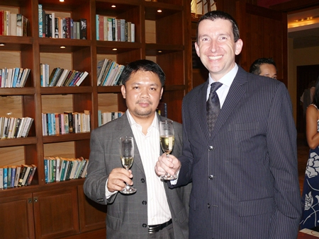 Anuchit Saeng-on and MD Michael Delargy raise their glasses to a good evening had by all.