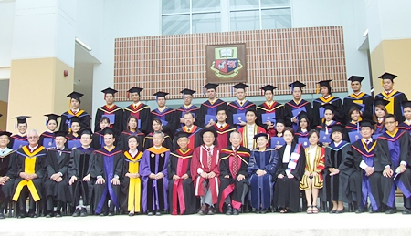 The graduates with the Asian U faculty.