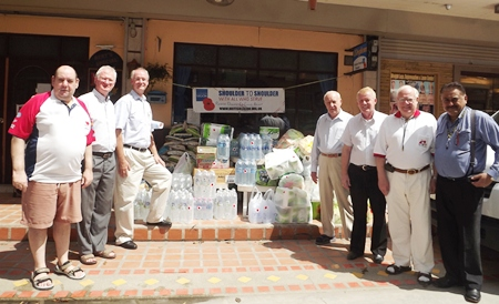 (L to R) Bert Elson, Philip Wall Morris, Dieter Reigber, Dennis Stark, Gudmund Eiksund, Brendan Kelly and Peter Malhotra prepare to load up rescue supplies to send to flood victims.