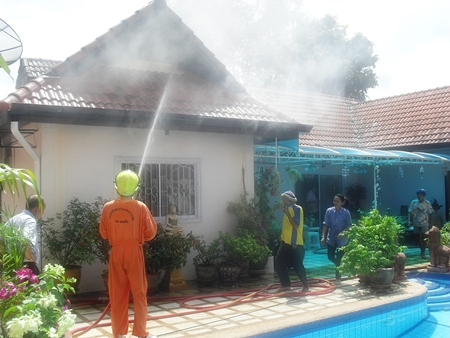 It took firefighters about an hour to fully extinguish the roof fire in Banglamung.