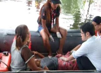 Doctors and emergency medical technicians help Rattana Thassanawadee deliver a baby boy aboard a rubber raft amidst all the flooding.