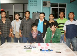 Rung Hokgenhul (right) and Rujiroj Theskhum have been arrested and charged with possessing 598 methamphetamine tablets.