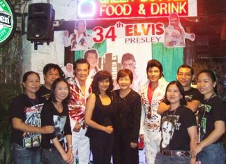 Two of Pattaya's Elvis impersonators, Jaluk Viriyakit and Jeerasak Pinsuwan, pose for a photo with Green Bottle owner Sopin Thappajug and friends.