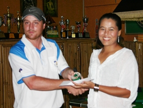 Ladies Flight winner May Mitchell is presented with her Medal.