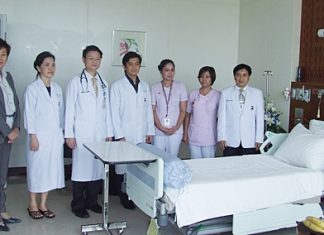 Hospital Director Dr. Pichit Kangwolkij (right) and a team of doctors announce the soon to be open IMCU.