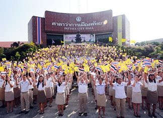 Staff at Pattaya City Hall join in the video shoot honoring His Majesty the King, Monday, November 21.