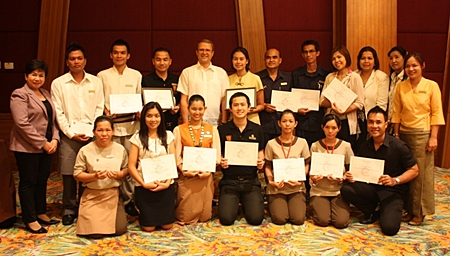 Employees of the Centara Grand Mirage Beach Resort Pattaya, under the watchful eye of Lily Eduardcoce (standing left) the training manager, pose proudly with their certificates of achievement at the end of their successful training sessions. Andre Brulhart (standing 5th left), the general manager, presented his staff with their recognitions, thanking them for their dedication for excellence in five star services.