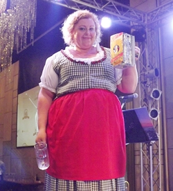 Peta Ruiter, the beer guzzling champion proudly holds up her trophy.