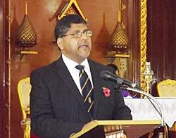 British Ambassador, HE Asif Ahmad, gives the reading.