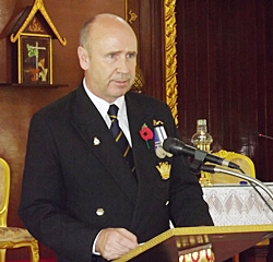 Legion member George Barrie addresses the congregation.