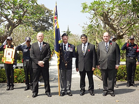 Graham Macdonald the president of the Royal British Legion Thailand with standard bearer  Richard Holmes, the British Ambassador and Bert Elson.