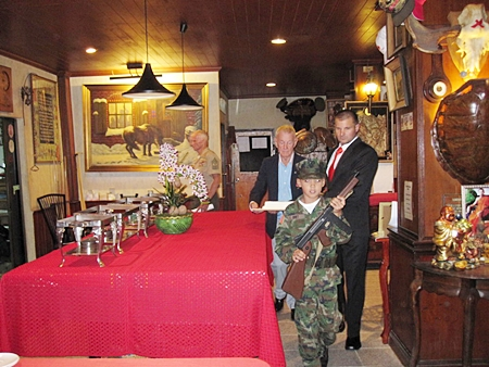 Young Marines' Pvt. Bret Mays leads out Cake Detail at the 236th U.S. Marine Corps Birthday Ball held in Pattaya at the Cafe Kronborg on 11 Nov. 2011. (L to R)  The Oldest Marine GySgt Billy Goodman born 2 April 1927, Young Marines' Pvt Bret Mays born 1 April 2002 and the Youngest Marine was Sgt David Dziabo born 10 July 1981.