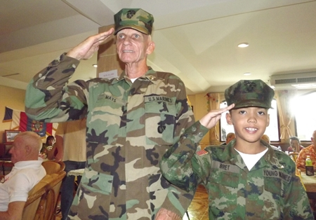 Young Marine Group gives a salute during Veterans Day ceremony. Post 9876 member Rad Mays and his son Young Marine Private Brett Mays.