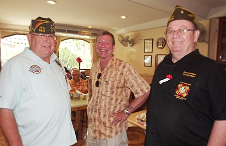 (L to R) Post 9876 Junior Vice Commander Pat Clark; Post 9951 Bangkok member Rick Reese; Post 9876 Commander 9876 Eric Larsen talking prior to start of Veterans Day ceremony.