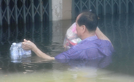 Emergency supplies help this man wait out the flooding in Bangkok.