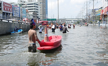 People slowly make their way towards safety in Bangkok.