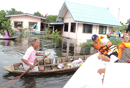 People make their way to the evacuation centre in Ayuthaya, Preedee Bridge, any way they can.