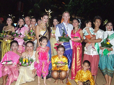 Locals and visitors dressed in Thai traditional clothes enjoy the festival in Jomtien Beach.