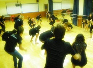 Students learning dance moves.