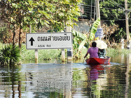 A quiet paddle up Asia Road - Lifestyles of the residents have completely changed because of the flood.