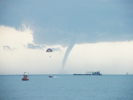 Jet skis and boat operators headed for shore when this monster waterspout showed up in Pattaya Bay on Wednesday afternoon, Oct. 26.  Waterspouts are usually weaker than their land-based cousins, the tornado, but can be dangerous nonetheless.