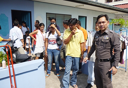 Pol. Lt. Col. Nanthawut Suwanla-Ong leads the gamblers out of the rented house.