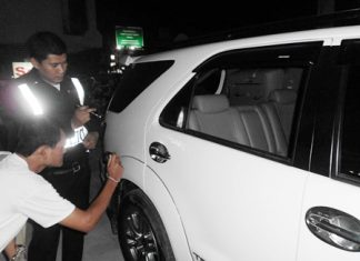 Police inspect and record the damage to Chukiet's Toyota Fortuner.