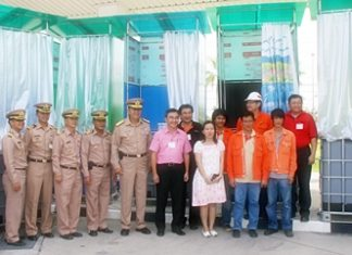 Company officials and Thai Navy officers prepare to ship out the floating toilets.