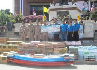 Officials from the Navy receive donated goods from the mayor and Walking Street committee to help flood-relief efforts around Thailand.