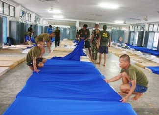 Navy cadets prepare beds for the incoming victims of devastating floods in Bangkok and beyond.