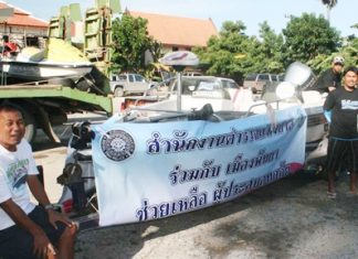 Local police load up boats and jet skis to bring supplies to flood victims in Pathum Thani.