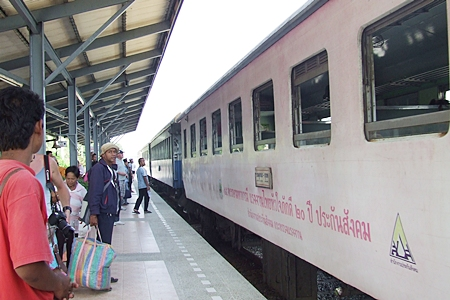 Passengers prepare to board the train at Pattaya Station off Siam Country Club Road.