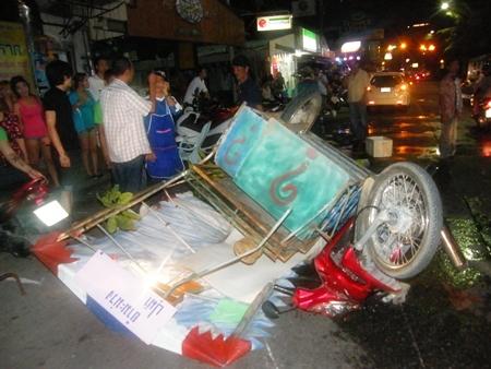 Bystanders gawk at the overturned papaya-poke-poke cart.
