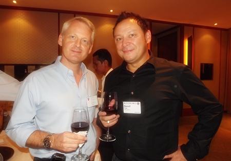 Alain Deurwaerder enjoys a drink with Russell Pang.