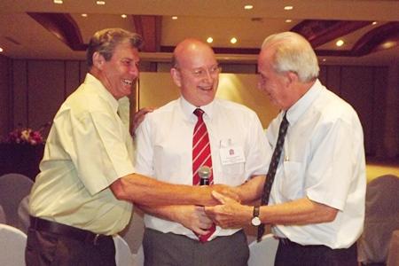 Graham Macdonald congratulates the birthday boys, Maurice Bromley and Dr. Iain.
