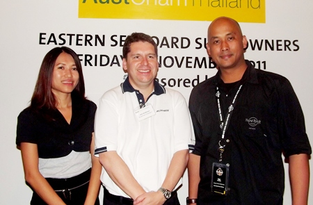 The president and main sponsors (L to R) Sarinya Holloway, sales and marketing manager for Strategic Airlines; AustCham President John Anderson; and Ian Sutedjo, director of sales and marketing for Hard Rock Hotel Pattaya.